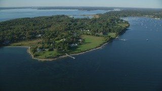 AX145_012 - 6k stock footage aerial video flying by waterfront mansions, green lawns, trees, Bristol, Rhode Island