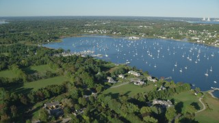 AX145_013 - 6k stock footage aerial video flying by waterfront mansions, Bristol Harbor, sailboats, Bristol, Rhode Island