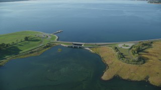 AX145_014 - 6k stock footage aerial video approaching and fly by a small bridge, tilt down, Bristol, Rhode Island