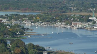 AX145_016 - 6k stock footage aerial video flying by small coastal town, waterfront properties, sailboats, Warren, Rhode Island