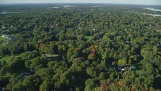 AX145_018 - 6k stock footage aerial video flying over residential neighborhood, trees, Barrington, Rhode Island