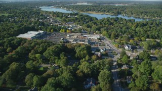 AX145_019 - 6k stock footage aerial video flying over County Road, approaching strip mall, Barrington, Rhode Island