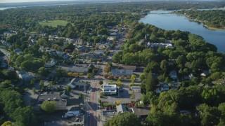 AX145_020 - 6k stock footage aerial video flying by County Road, neighborhoods, shops, Barrington, Rhode Island