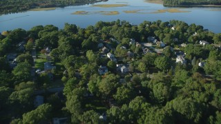 AX145_022 - 6k stock footage aerial video flying over neighborhood, approach Hundred Acre Cove, Barrington, Rhode Island