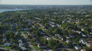 AX145_028 - 6k stock footage aerial video flying over suburban neighborhoods, East Providence, Rhode Island