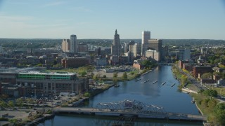 AX145_034 - 6k stock footage aerial video flying over small bridge, Providence River, Downtown Providence, Rhode Island