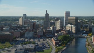AX145_035 - 6k stock footage aerial video flying over river, approaching Downtown Providence, Rhode Island