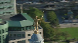 AX145_040 - 6k stock footage aerial video orbiting gold statue atop the Rhode Island State House, Providence, Rhode Island