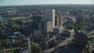 AX145_043 - 6k stock footage aerial video orbiting downtown buildings and skyscrapers, Downtown Providence, Rhode Island
