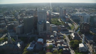 AX145_044 - 6k stock footage aerial video orbiting downtown buildings and skyscrapers, Downtown Providence, Rhode Island