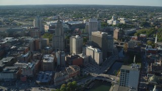 AX145_046 - 6k stock footage aerial video orbiting buildings and skyscrapers, Downtown Providence, Rhode Island