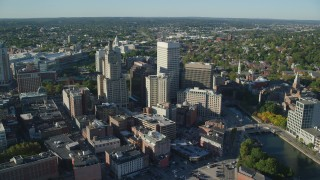 AX145_047 - 6k stock footage aerial video orbiting buildings and skyscrapers, Downtown Providence, Rhode Island