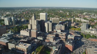 AX145_048 - 6k stock footage aerial video orbiting buildings and skyscrapers, Downtown Providence, Rhode Island