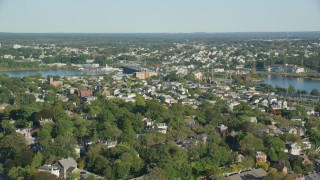 AX145_060 - 6k stock footage aerial video flying by a residential neighborhood, pan left, Providence, Rhode Island