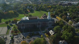 AX145_067 - 6k stock footage aerial video approaching Hope High School, tilt down, Providence, Rhode Island