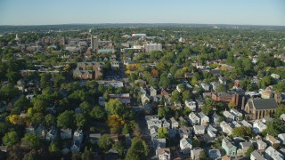 AX145_070 - 6k stock footage aerial video approaching Brown University, colorful trees, Providence, Rhode Island