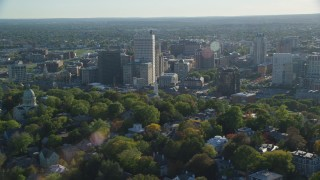 AX145_075 - 6k stock footage aerial video flying by buildings and skyscrapers, Downtown Providence, Rhode Island