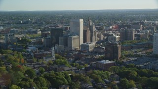 AX145_076 - 6k stock footage aerial video flying by buildings and skyscrapers, Downtown Providence, Rhode Island