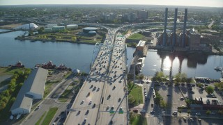 AX145_081 - 6k stock footage aerial video of Providence River Bridge, power plant, smoke stacks, Providence, Rhode Island