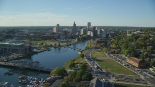AX145_084 - 6k stock footage aerial video flying by Providence River, approach skyline, Downtown Providence, Rhode Island
