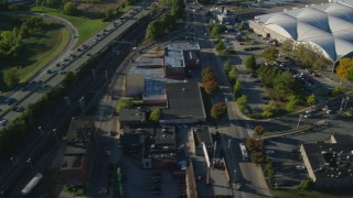 AX145_089 - 6k stock footage aerial video flying by interchange, reveal US Post Office warehouse, Providence, Rhode Island