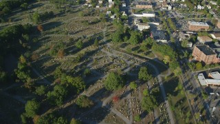 AX145_090 - 6k stock footage aerial video of a bird's eye view over North Burial Ground, autumn, Providence, Rhode Island