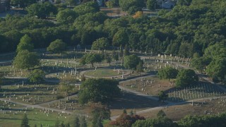 AX145_092 - 6k stock footage aerial video flying by a cemetery, green trees, Providence, Rhode Island