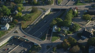AX145_095 - 6k stock footage aerial video flying away from  Interstate 95, tracking cars, Pawtucket, Rhode Island