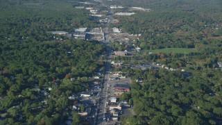 AX145_097 - 6k stock footage aerial video of a small town, Washington Street, strip malls, autumn, Attleboro, Massachusetts