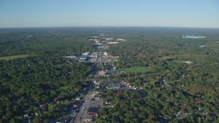 AX145_098 - 6k stock footage aerial video flying over Washington Street, strip malls, autumn, Attleboro, Massachusetts