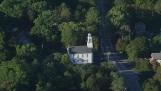AX145_100 - 6k stock footage aerial video flying by First Congregational Church, tilt down, North Attleborough, Massachusetts