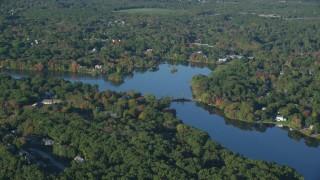 AX145_101 - 6k stock footage aerial video approaching, flying over Lake Hiawatha, autumn, North Attleborough, Massachusetts