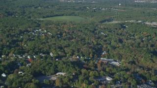 AX145_102 - 6k stock footage aerial video of Lake Hiawatha, waterfront homes, autumn, North Attleborough, Massachusetts