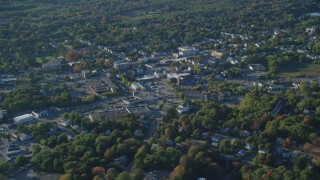 AX145_104 - 6k stock footage aerial video flying by small town center, autumn, North Attleborough, Massachusetts