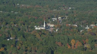 AX145_108 - 6k stock footage aerial video flying by small town and church, autumn, Foxborough, Massachusetts