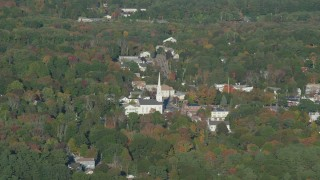 AX145_109 - 6k stock footage aerial video flying by small town and church, autumn, Foxborough, Massachusetts