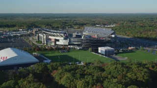 AX145_117 - 6k stock footage aerial video approaching Gillette Stadium, autumn, Foxborough, Massachusetts