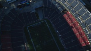 AX145_119 - 6k stock footage aerial video of a bird's eye view flying over Gillette Stadium, Foxborough, Massachusetts
