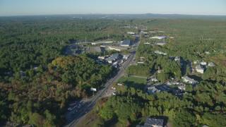 AX145_121 - 6k stock footage aerial video flying over Boston Providence Highway, warehouses, autumn, Walpole, Massachusetts