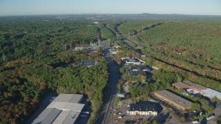 AX145_123 - 6k stock footage aerial video of Boston Providence Highway, warehouses, Interstate 95, Walpole, Massachusetts