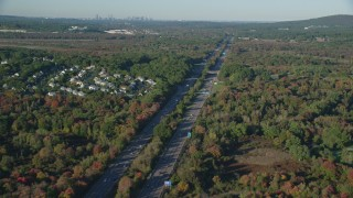 AX145_128 - 6k stock footage aerial video flying by Interstate 95, colorful trees, autumn, Norwood, Massachusetts