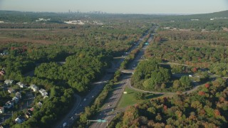 AX145_129 - 6k stock footage aerial video flying by Interstate 95, trees in autumn, Norwood, Massachusetts