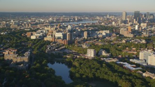 AX146_012 - 6k stock footage aerial video of Longwood Medical Area, reveal skyline, Downtown Boston, Massachusetts, sunset
