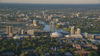 AX146_014 - 6k stock footage aerial video approaching Agganis Arena, apartments, Charles River, Boston, Massachusetts, sunset