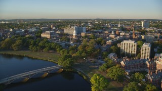 AX146_019 - 6k stock footage aerial video flying over Chalres River, approach Harvard University, Massachusetts, sunset