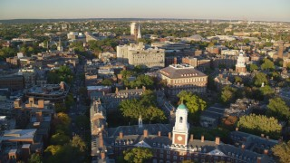 AX146_020 - 6k stock footage aerial video orbiting Eliot House, reveal Lowell House, Harvard University, Massachusetts, sunset