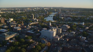 AX146_022 - 6k stock footage aerial video flying by Harvard University, Cambridge, Massachusetts, sunset