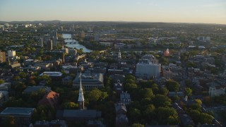 AX146_023 - 6k stock footage aerial video flying by Harvard University, Cambridge, Massachusetts, sunset