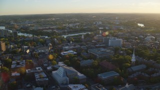 AX146_024 - 6k stock footage aerial video orbiting Harvard University, Cambridge, Massachusetts, sunset