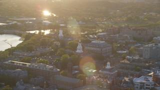 AX146_026 - 6k stock footage aerial video orbiting Harvard University, Cambridge, Massachusetts, sunset